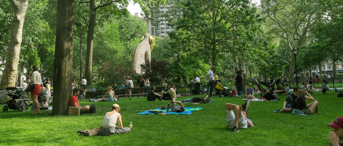 People Enjoying the Day in Madison Square Park NYC Near Kew Management Offices